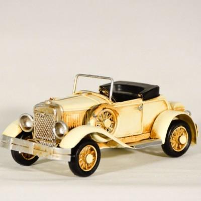 Vintage μεταλλικό εκρού καμπριολέ αυτοκίνητο